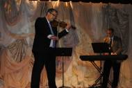 José Bas and Gregg Simmons performing for our guests
