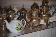 Loose leaf tea served from silver and fine china tea pots