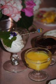 Freshly prepared clotted cream, lemon curd, and fruit preserves