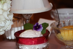 Clotted cream on display with a fresh floral embellishment