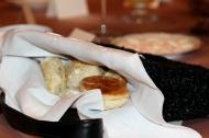 Freshly prepared scones tucked inside vintage purses